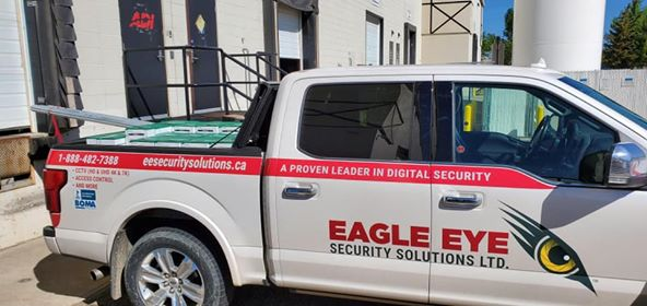 Eagle Eye Pickup Truck with boxes of cable in the back.